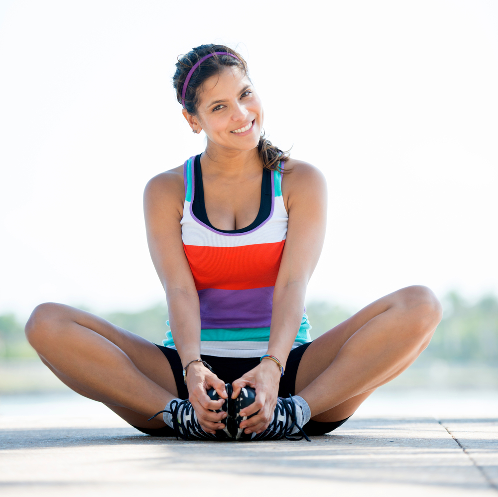 Beautiful woman exercising outdoors and looking very happy