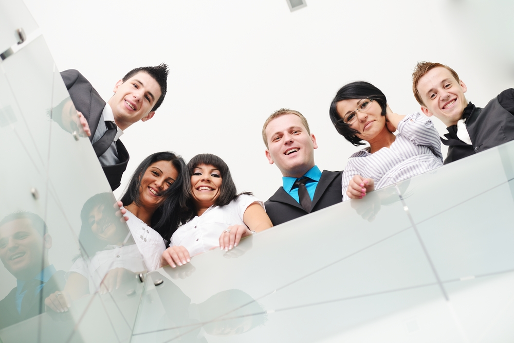 Group of business people standing in office
