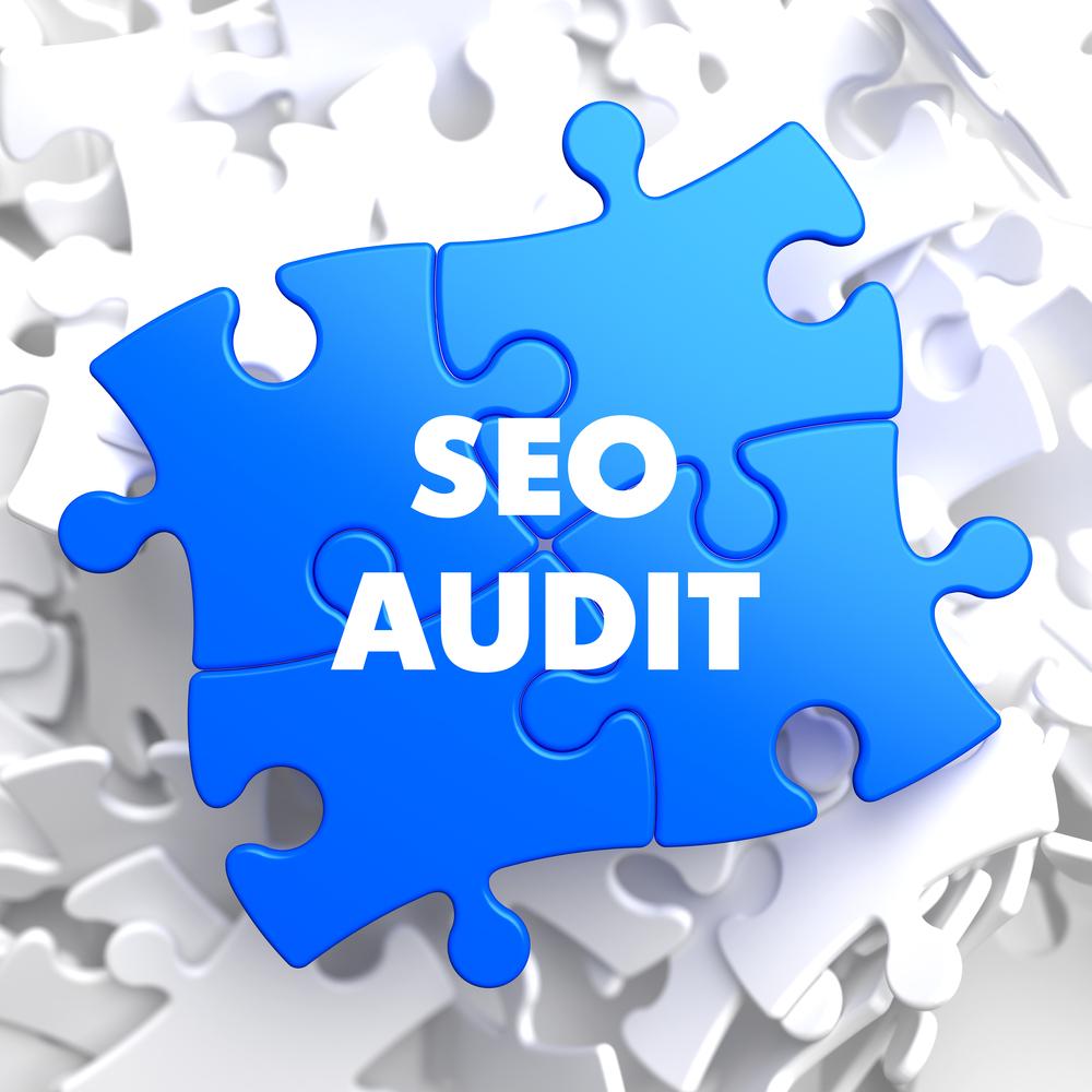 SEO Audit on Blue Puzzle on White Background.